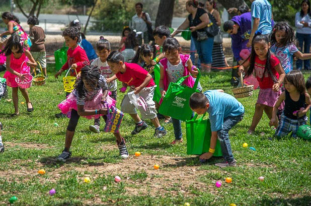 Kids hunt for eggs at Arroyo Seco NC's Spring Eggstravaganza Saturday March 31