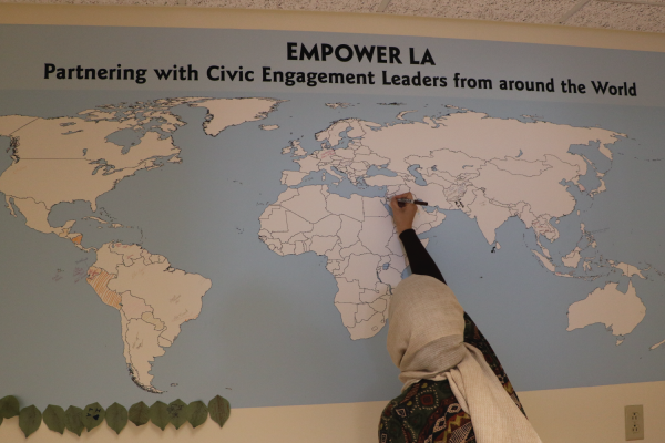 International visitors signing the map in EmpowerLA's City Hall office