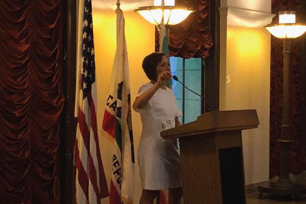 Ignite graduation photo Spring 2018 - Ana Guerrero (Chief of Staff for Mayor Garcetti) addresses the crowd